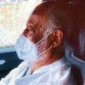 Rajinikanths driving car with a mask