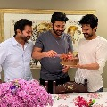 ram charan gives surprize to sharvanand