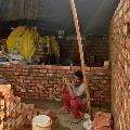 farmers constructing homes