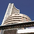 Sensex loses 871 points