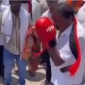 DMK candidate KP Shankar boxing in his election campaign