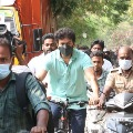 Tamil star hero Vijay arrives by bicycle to cast his vote in Chennai