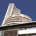 Sensex closes 558 points high