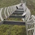 Man Left Dangling From 330 Foot Glass Bridge As Strong Winds Shatter Panels