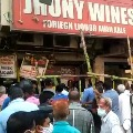 People rushes to wine shops after lock down announcement in Telangana