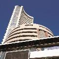 Sensex closes 471 points low