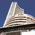 Sensex gains 976 points