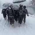 Jawans carries mother and her new born child
