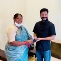 Seethakka ties Rakhi to Revanth Reddy as gifted him with a mask and sanitizer