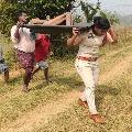 Kasibugga SI Sirisha carries an unidentified man dead body for two kilometers