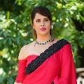 anchor Anasuya looks elegant in her red coloured saree pics