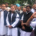 Rahul Gandhi and other Congress MPs protest near Mahatma Gandhi statue at Parliament