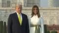 US President Donald Trump writes in visitors book at Taj Mahal