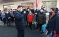 Xi Jinping visites Corona camp wearing mask